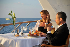 couple having dinner on a cruise ship